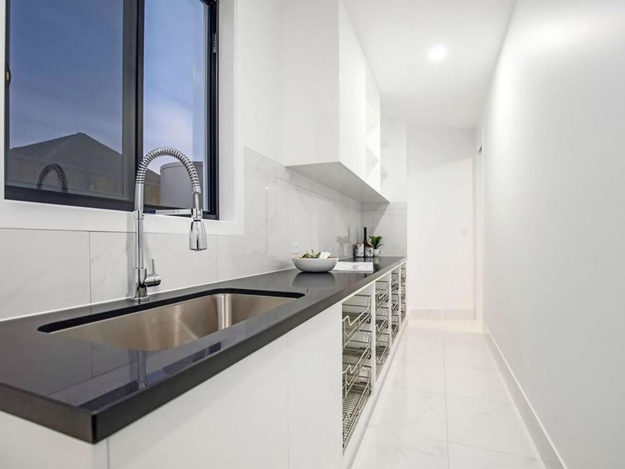 Butlers pantry view of Custom luxury home built